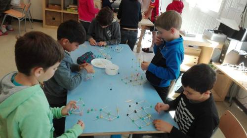 Elementary school children creating their structures.