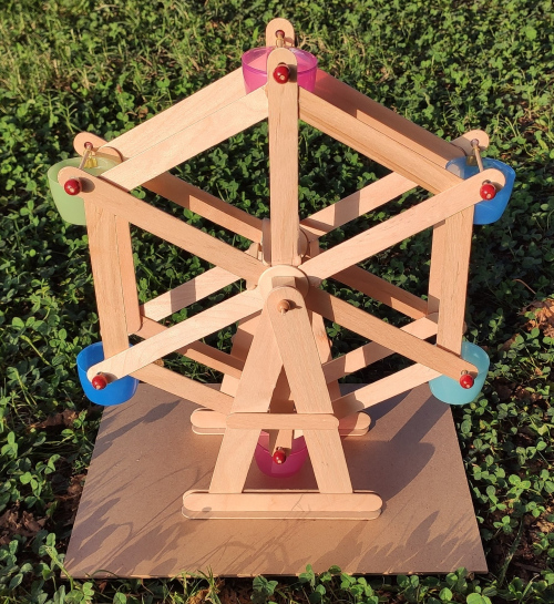 We made a ferris wheel with wooden sticks and recycled caps