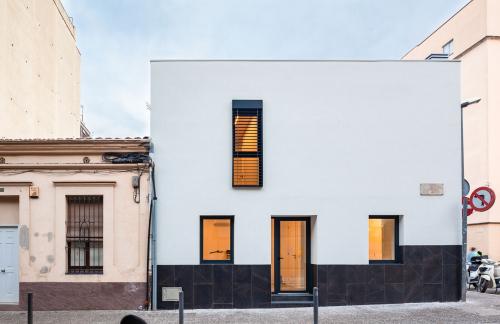 Gràcies a la tecnologia lleugera de fusta utilitzada s'ha ampliat un pis per sobre sense haver de reforçar els fonaments.